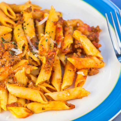 Mostaccioli with penne pasta, a red sauce and hamburger meat- topped with cheese