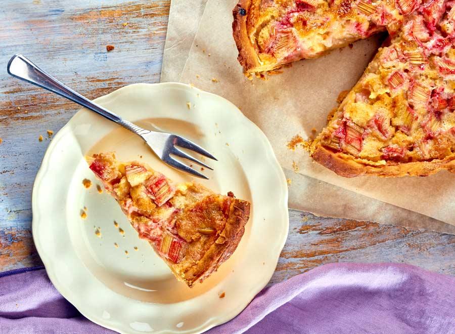 Rhubarb Custard Pie on a plate with a fork
