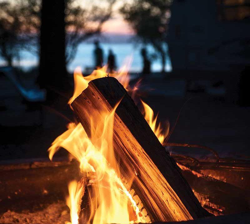 A campfire by a lake