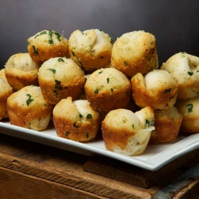 baked garlic cheese bombs on a plate
