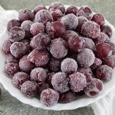 A bowl of frozen grapes.