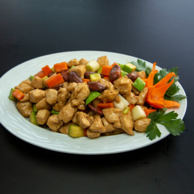 Stir Fry Chicken and vegetables on a white plate.