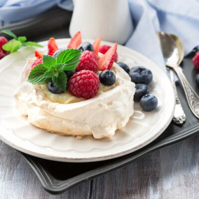 Pavlova topped with fresh berries.