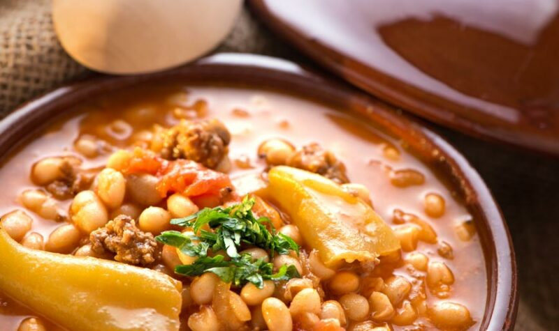 A bowl of pineapple baked beans with ground beef.